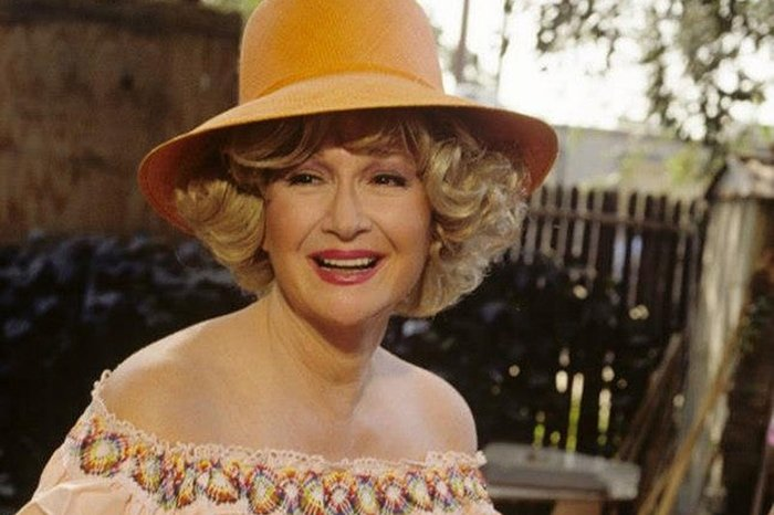 Diane Ladd as Lucille (Southern belle) in Hold Me Thrill Me Kiss Me, a 1992 American comedy film