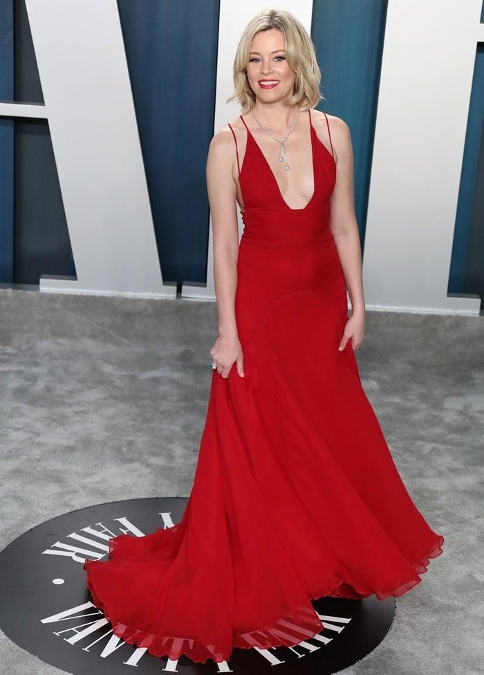Elizabeth Banks rocks a red Badgley Mischka dress at the 2020 Vanity Fair Oscar Party
