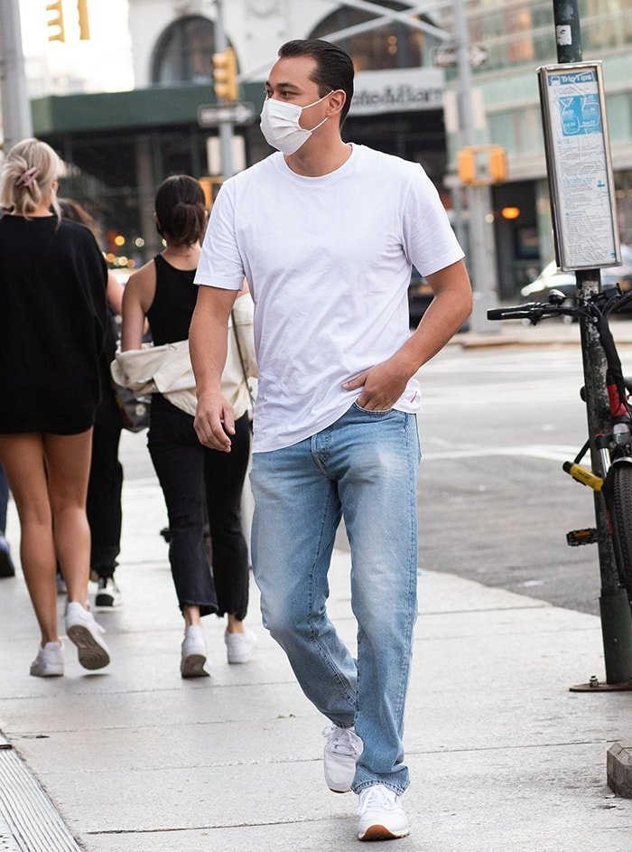 Emilio Vitolo Jr. looks fresh in a white tee, denim jeans, and white sneakers