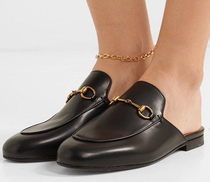 Gucci's loafers are crafted from smooth black leather and are a versatile option for the office or evenings out