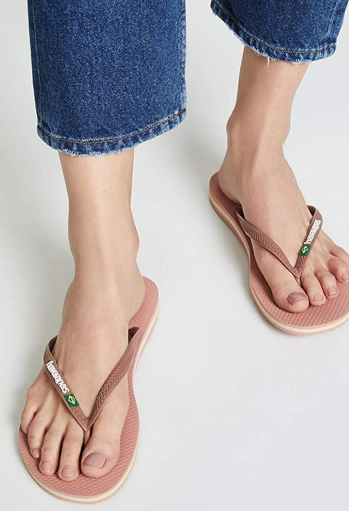 The Havaianas Slim Brazil flip-flops are the perfect getaway-ready sandal with a thong-style construction, logo-detailed straps, and easy slip-on styling