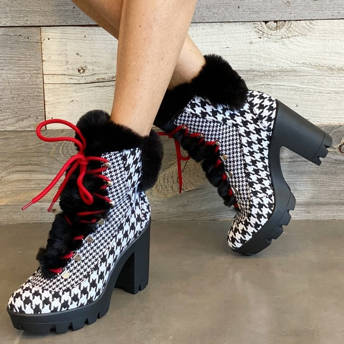 Fuzzy fleece trim amplifies the Arctic appeal of a lace-up platform bootie that's a stylish cold-weather standout