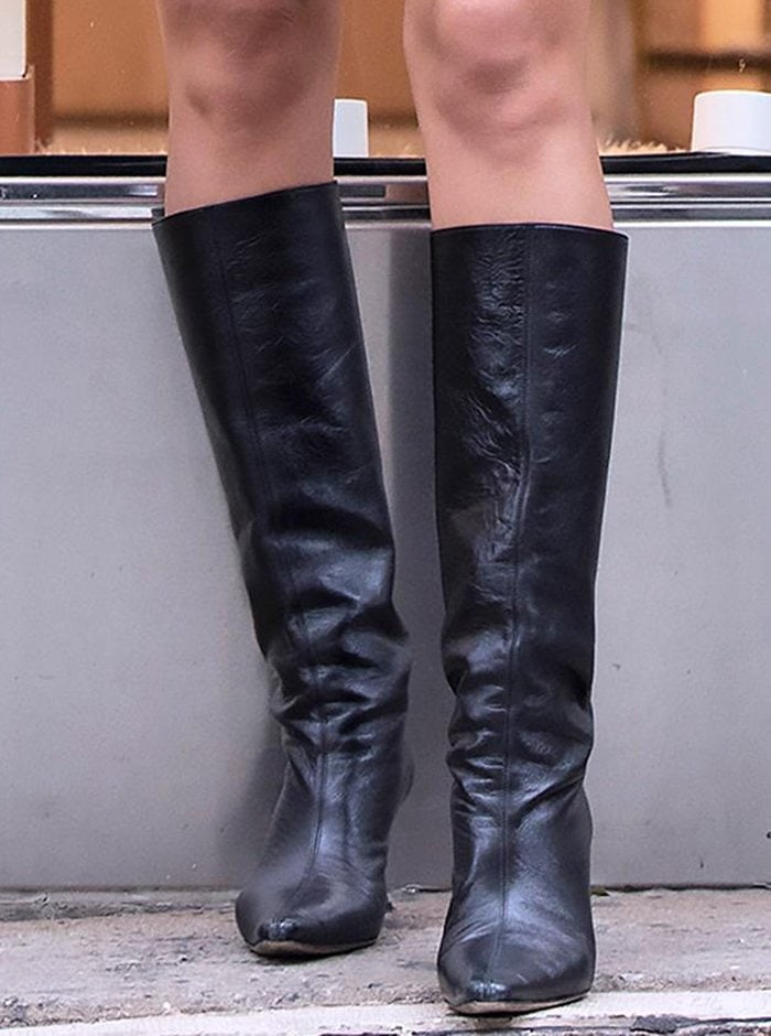 Irina Shayk completes her fall look with By Far mid-calf boots