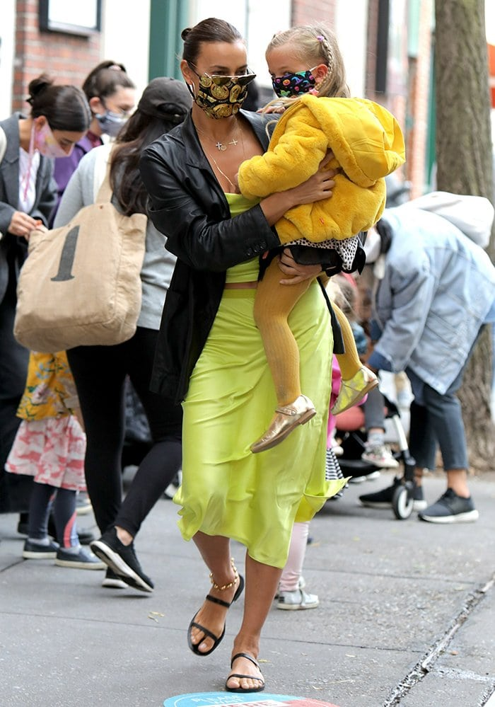 Irina Shayk wears a Cami NYC camisole and a matching midi skirt with J Brand x Elsa Hosk jacket