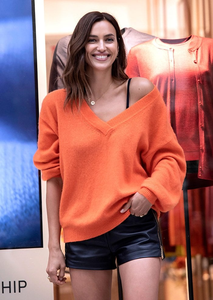 Irina Shayk styles her brunette hair in waves and wears earth-tone makeup