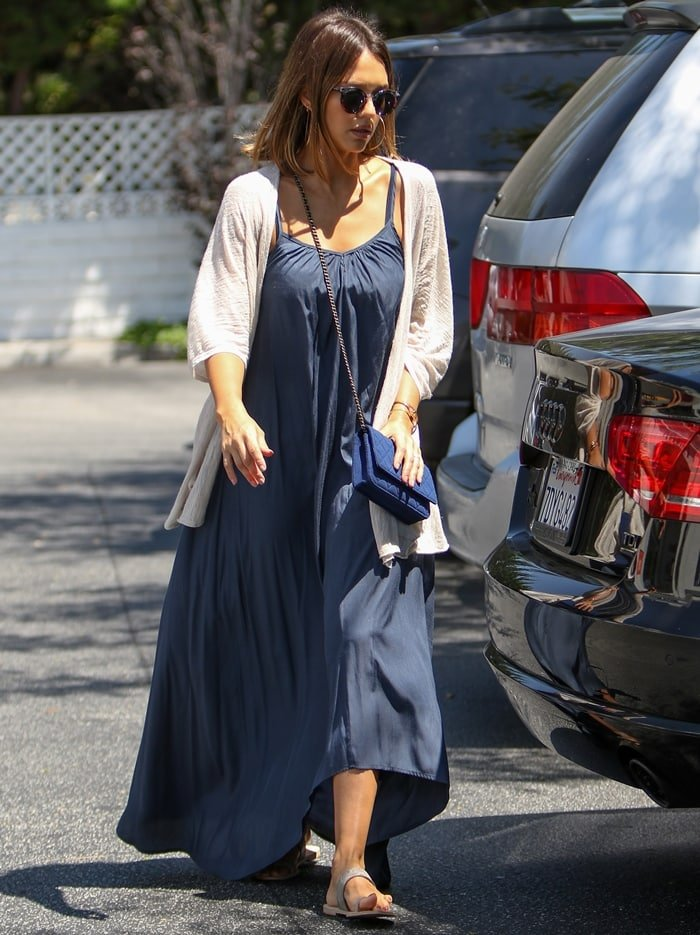 Jessica Alba wears Ariat's popular Copper Creek sandals with a maxi dress and cardigan