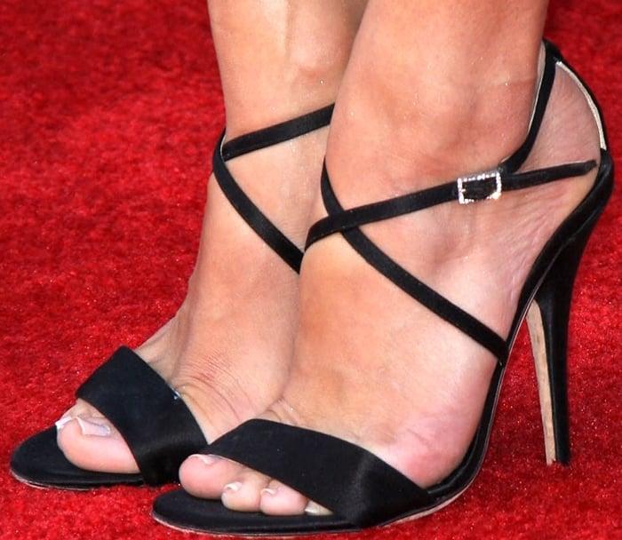 Jill Wagner, who wears shoe size 9 (US), shows off her feet in black stiletto heels