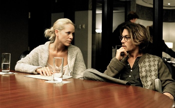 "Johnny Depp as Morton ""Mort"" Rainey and Maria Bello as Amy Rainey in Secret Window, a 2004 American psychological horror-thriller film"