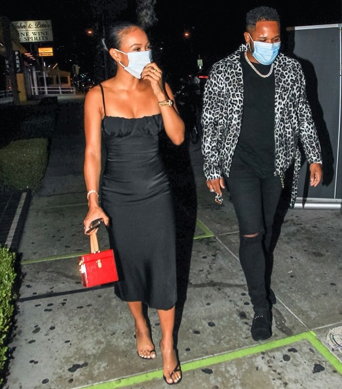 Karrueche Tran joins her close friend EJ King for a rooftop birthday party