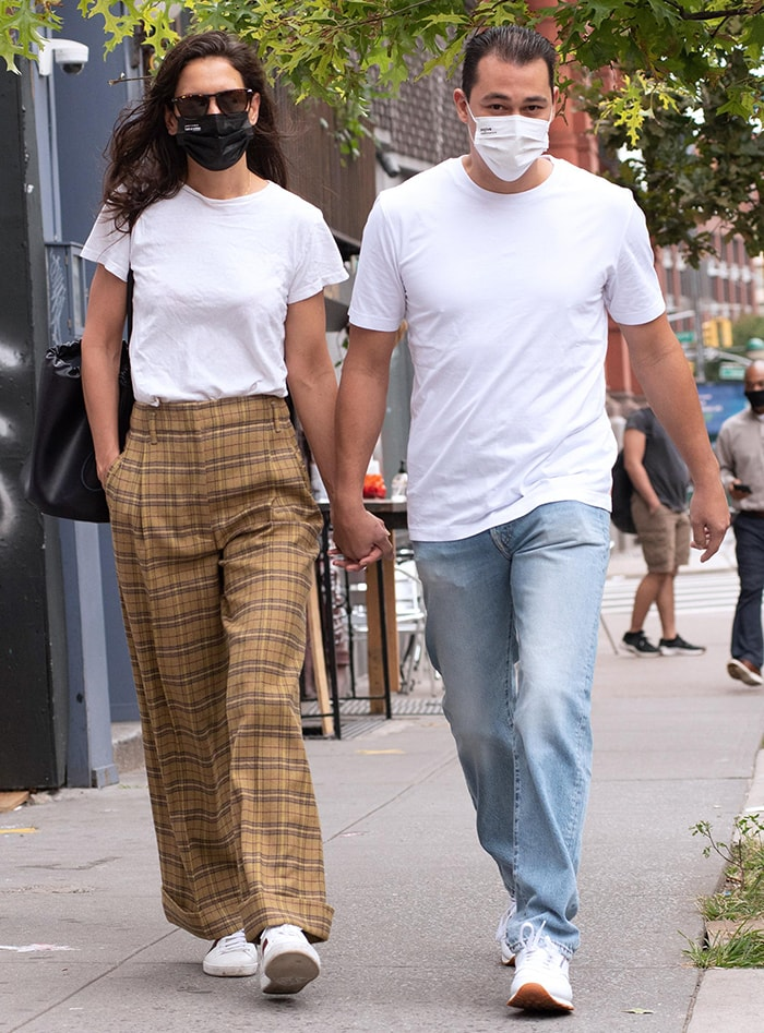Katie Holmes steps back to the '90s in yellow plaid baggy pants and white tee