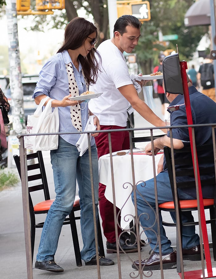 Katie Holmes wears a striped blue-and-white shirt with baggy jeans and Gucci loafers for the lunch out