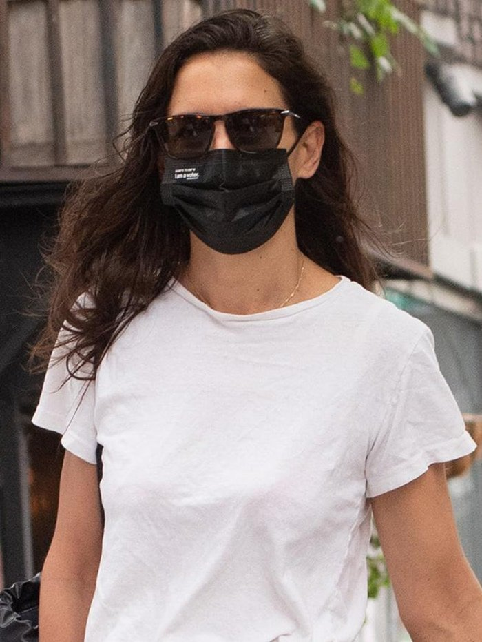 Katie Holmes wears her hair loose and keeps a low-key look with sunglasses and face mask