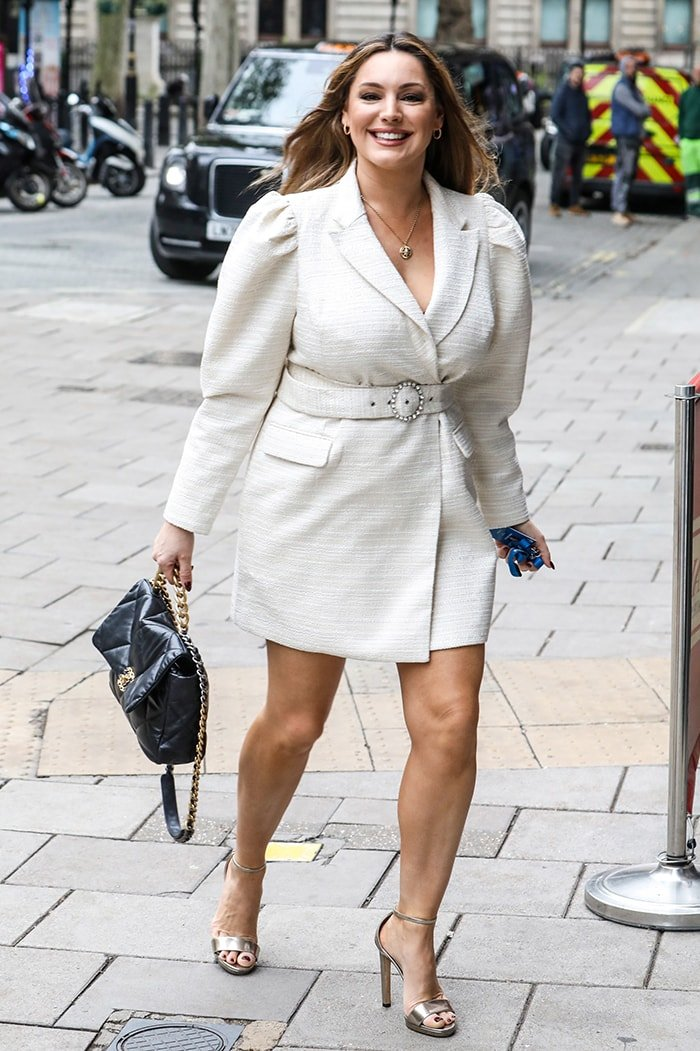 Kelly Brook parades her shapely legs in a Lavish Alice cream boucle blazer dress