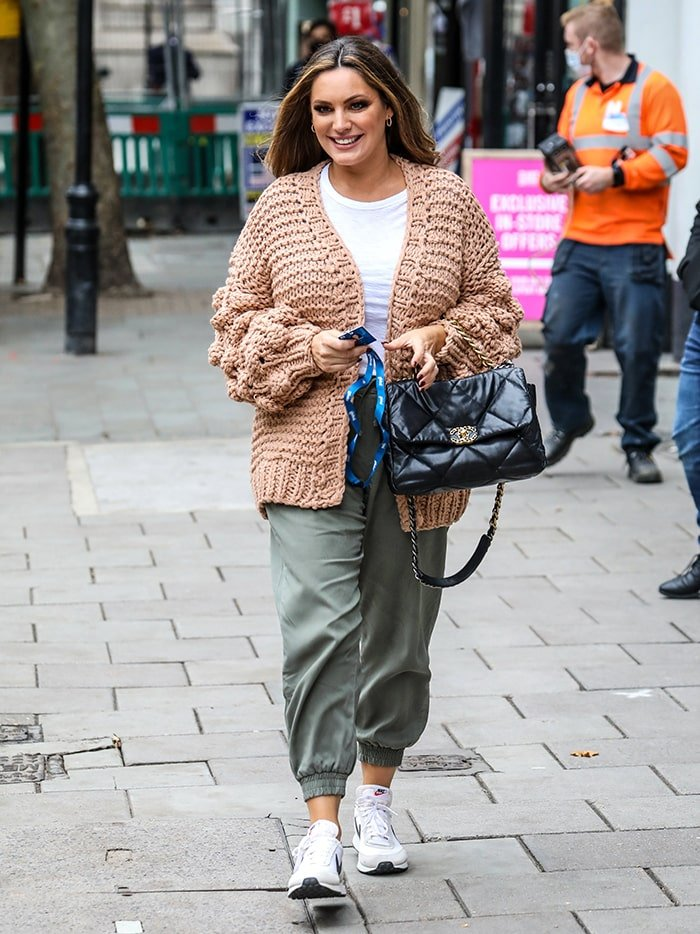 Kelly Brook goes casual in a beige knit cardigan and khaki green joggers on October 14, 2020