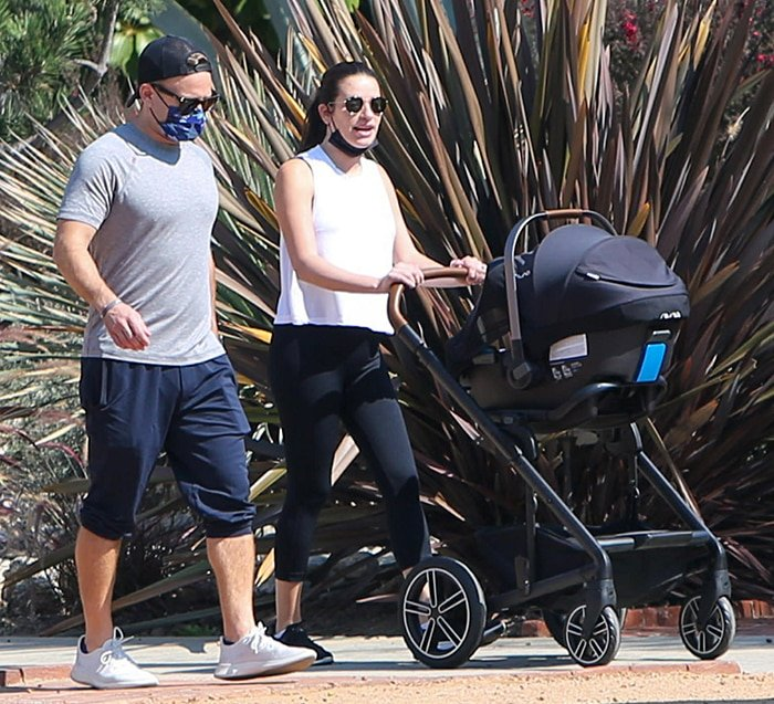 Zandy Reich wears a gray tee with cropped sweats while Lea dons a monochrome athleisure