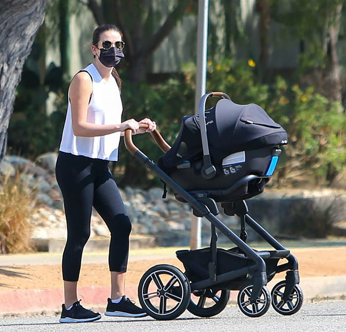 Lea Michele keeps it low-key with Ray-Ban Hexagonal sunglasses and black face mask