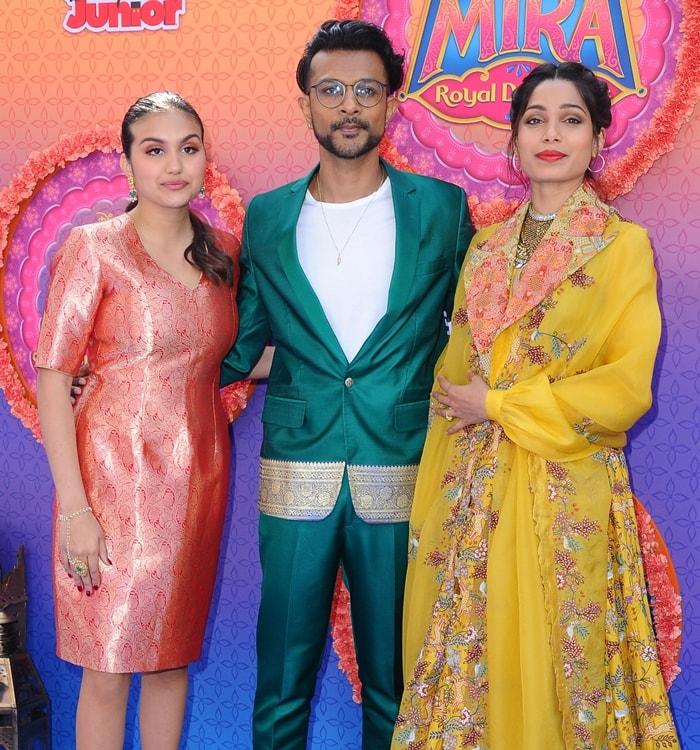 Leela Ladnier, Utkarsh Ambudkar, and Freida Pinto attend the premiere of Disney Junior's