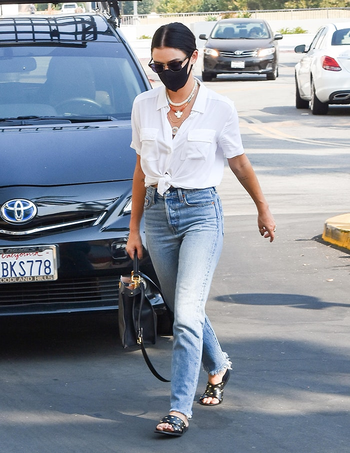 Brunette Lucy Hale runs errands wearing Levi's Wedgie Icon Fit jeans