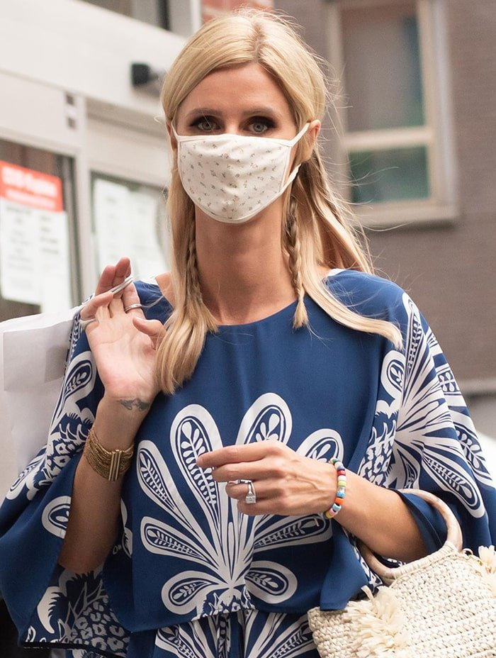 Nicky Hilton wears her hair down with braids and stays safe with a printed cloth face mask