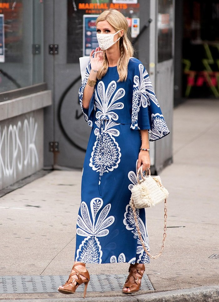 Nicky Hilton cuts a chic figure in a blue and white La DoubleJ maxi dress with pineapple print painted by artist Kirsten Synge