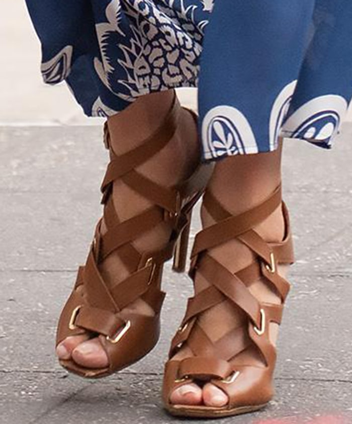 Nicky Hilton shows off her feet in strappy brown high heel sandals