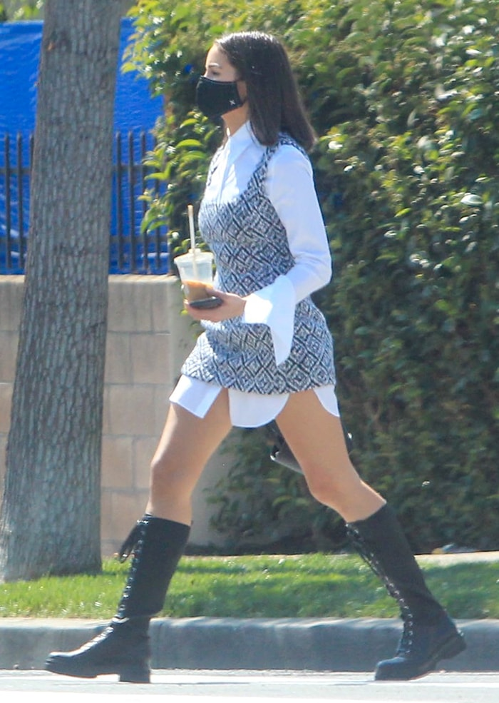 Olivia Culpo shows her layering skills in Tod's oversized white shirt and mini dress