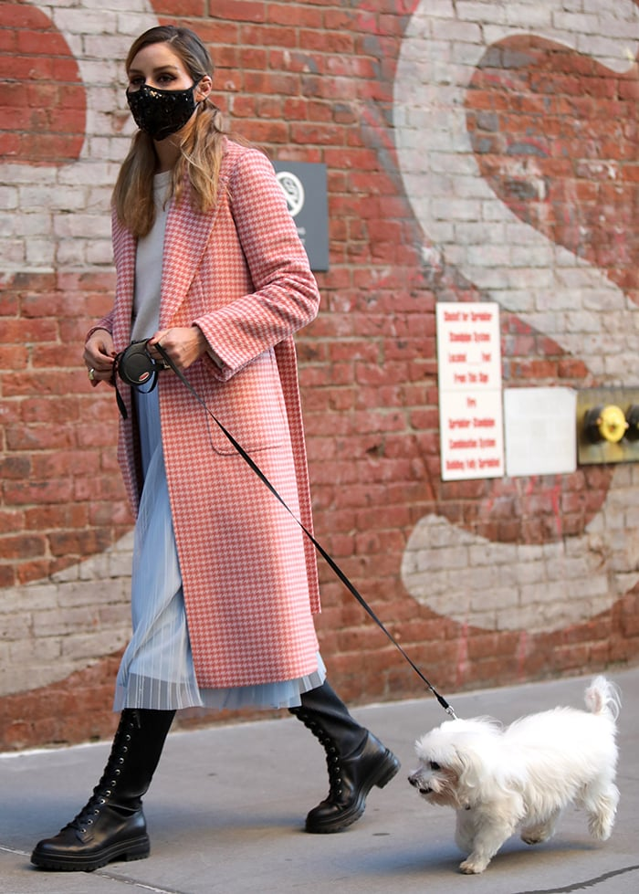Olivia Palermo teams a pink houndstooth coat with sheer midi skirt and gray sweater