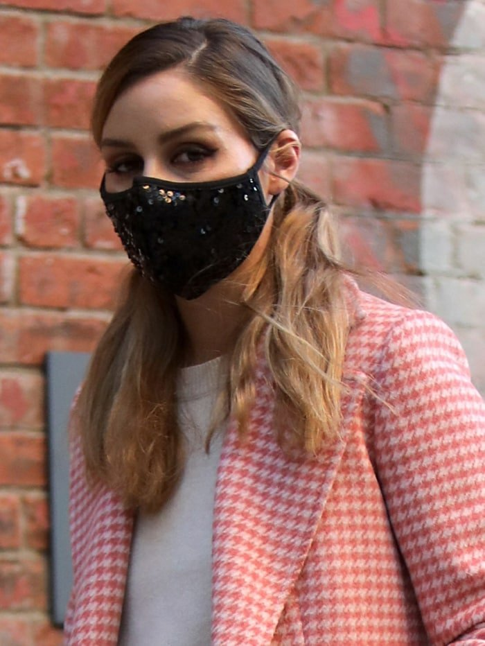 Olivia Palermo wears a stylish sequined face mask for protection against coronavirus