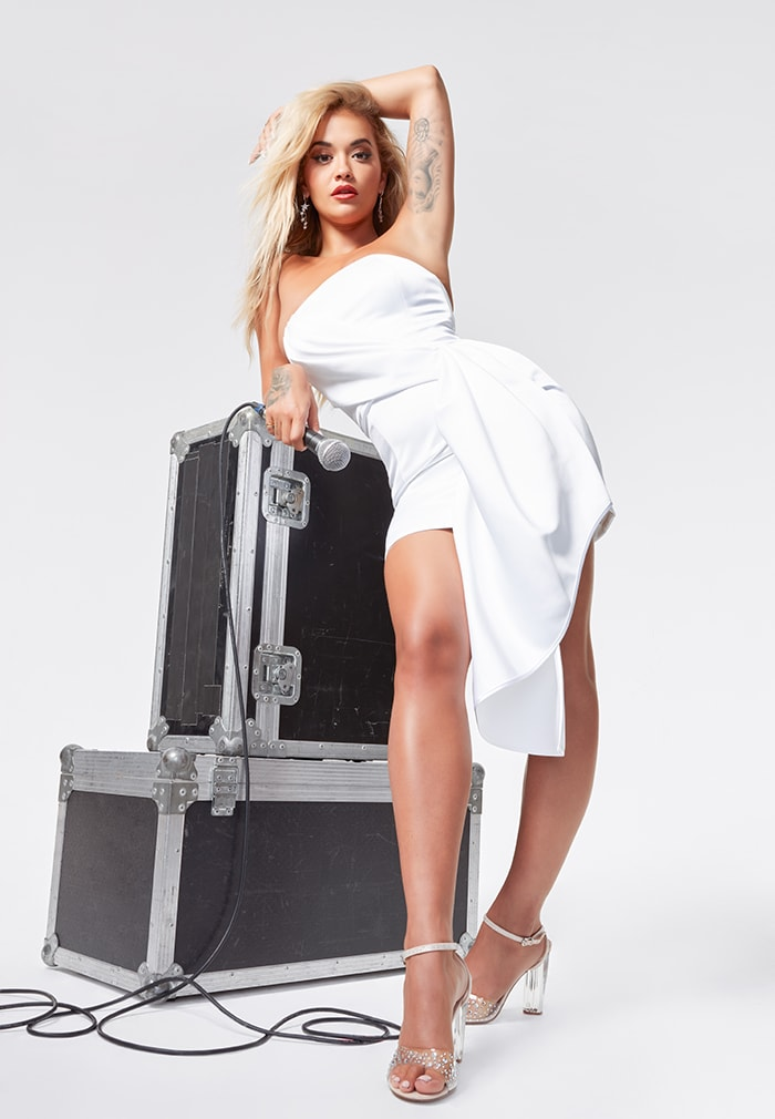 Rita Ora stuns in white dress and I See You jeweled sandals