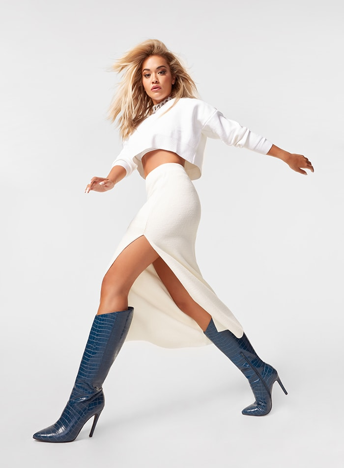 Rita Ora is white-hot in cropped top, midi skirt, and Night Is Young asymmetrical stiletto boots