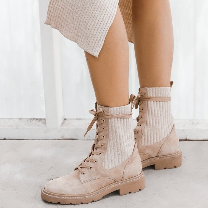 Tough gets cozy on this lug-sole combat boot featuring ribbed knit insets in the shaft that make the fit just right