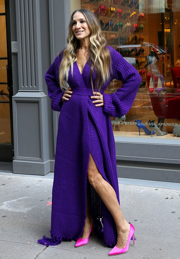 Sarah Jessica Parker shows off her fashion credentials in a purple Hanifa knit cardigan wrap maxi dress