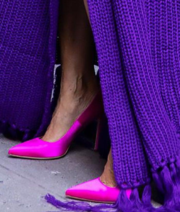 Sarah Jessica Parker teams her purple dress with pink SJP pumps