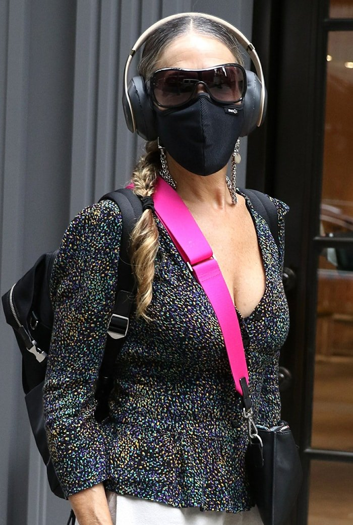 Sarah Jessica Parker shows off her cleavage and stays safe with a chain-detailed face mask