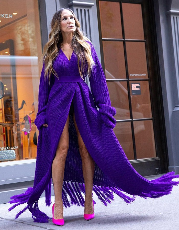 Sarah Jessica Parker accidentally flashes her knickers in a purple knit maxi dress