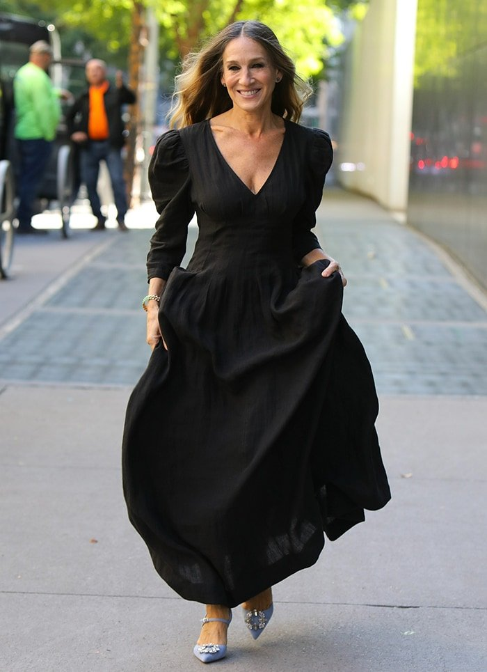 Sarah Jessica Parker trades her purple cardigan dress for a long black maxi