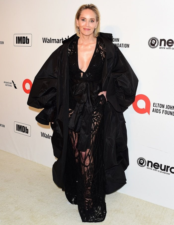 Sharon Stone wearing an Elie Saab jumpsuit with an Ashi Studio cape at the 2020 Elton John AIDS Foundation Oscars Viewing Party