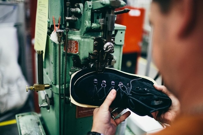 Stitching the upper to the midsole at Danner's factory in Portland, Oregon