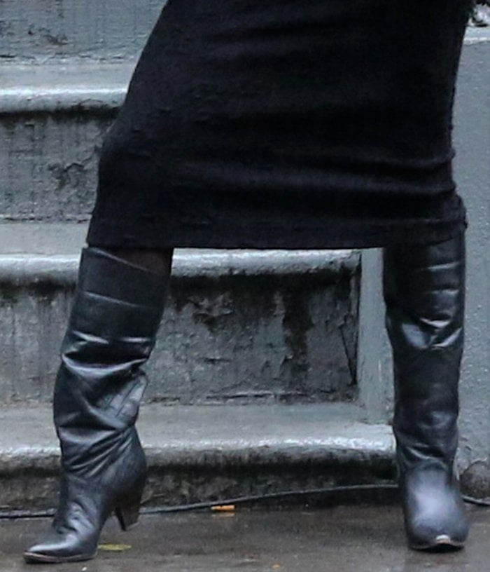 Vanessa Hudgens slips into a pair of black leather boots