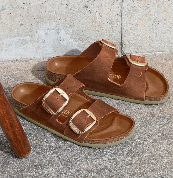 Treat your feet with Birkenstock's comfortable two-strap Arizona big buckle sandals