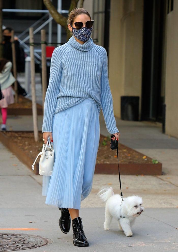 Olivia Palermo walks her dog Mr. Butler in New York City on October 24, 2020
