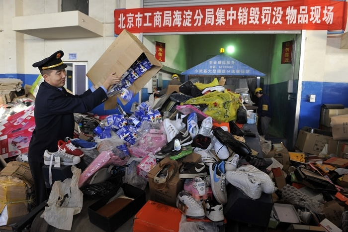 Thousands of fake phones and shoes pile up at a warehouse in China after a massive crackdown on counterfeit goods