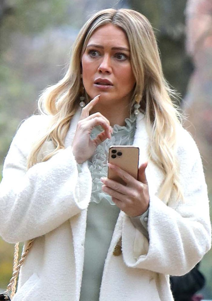 Hilary Duff wears glammed up makeup with tousled long blonde hair