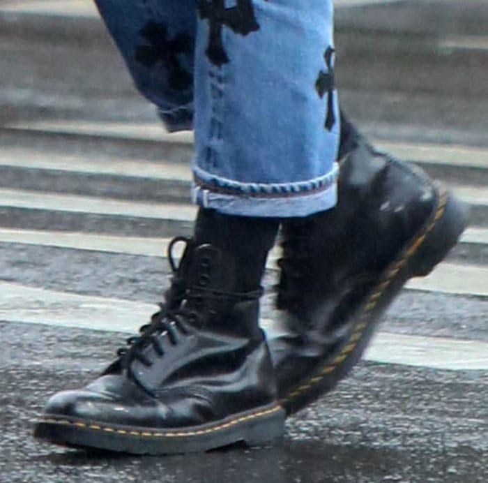 Irina Shayk completes her rainy day look with Dr. Martens 1460 boots