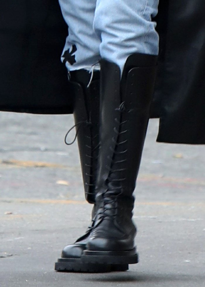 Irina Shayk completed her grungy, androgynous look with Magda Butrym knee-high boots