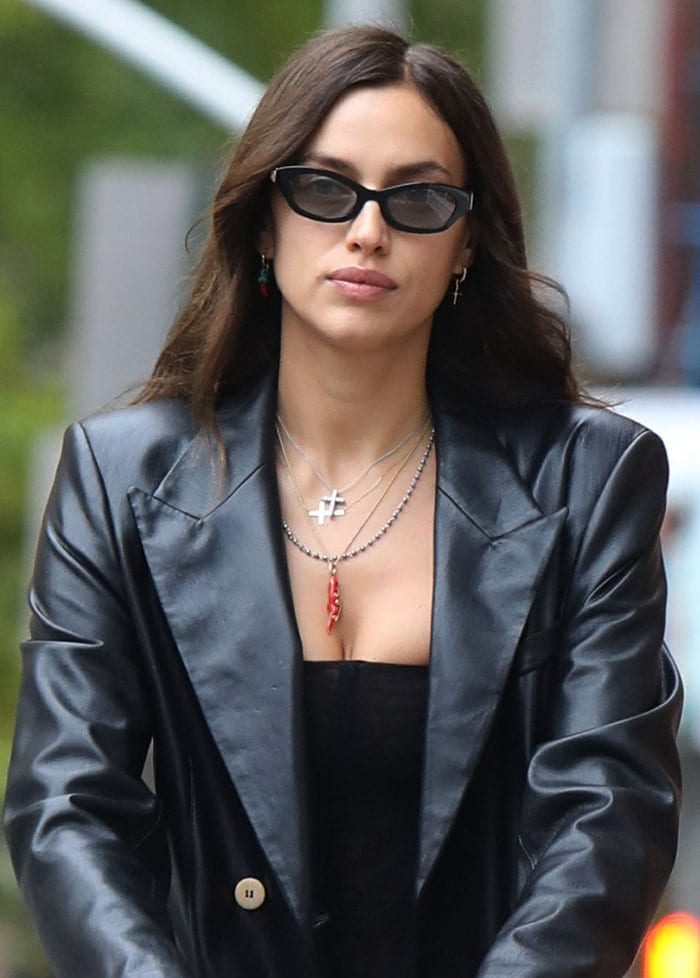 Irina Shayk styles her cool getup with Poppy Lissiman sunglasses and layered necklaces