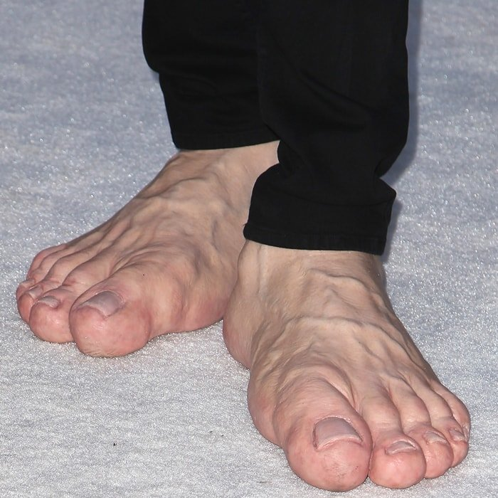Jim Carrey wears enormous prosthetic feet to Elton John's 2013 AIDS Foundation Academy Awards Viewing Party