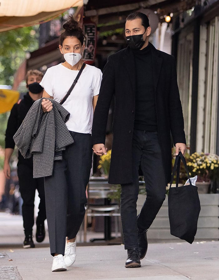 Emilio Vitolo Jr. is dapper with a slicked-back hairstyle and an all-black outfit