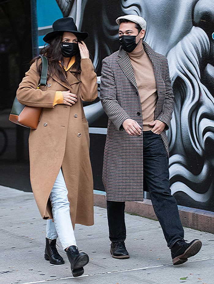 Emilio Vitolo Jr. looks handsome in a houndstooth-patterned coat with beige mock turtleneck top and jeans