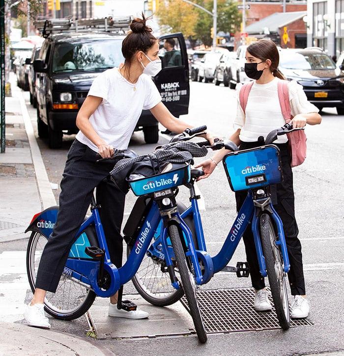 Katie Holmes and daughter Suri Cruise go biking Citi Bike around New York City on October 19, 2020